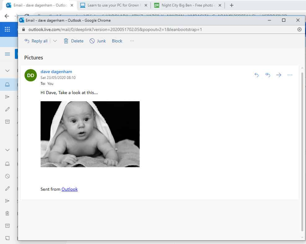 An email from sent from Outlook.com address with image inserted into body of message.