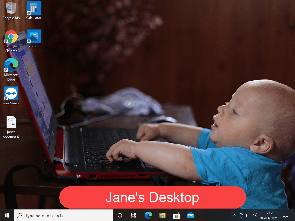 """Windows Desktop with an image of a young child using a laptop set as the background image. Slogan reads """"Jane's desktop"""""""