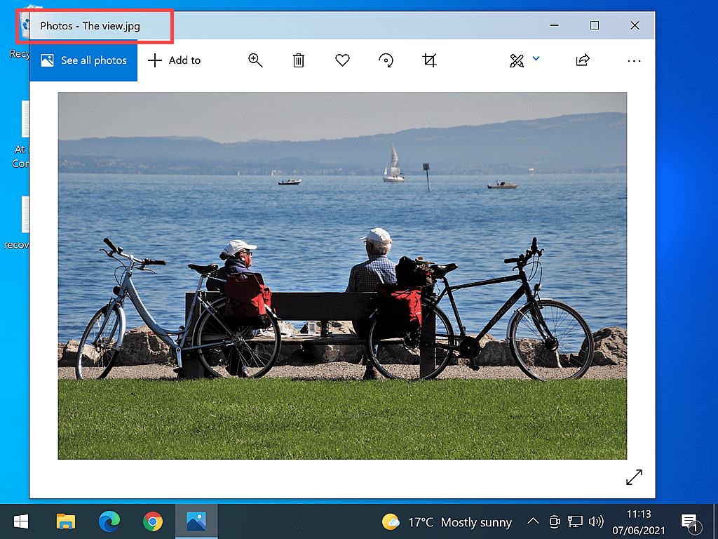Photo of two people on a bench shown in Windows Photo app.