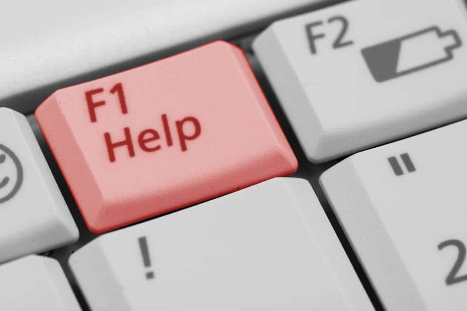 """Keyboard with a highlighted key that reads """"F1 Help"""""""
